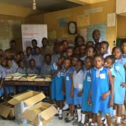 Pupils and Teachers at CMS Primary School, Lagos receiving books donated by VOS Foundation-
